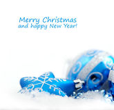 Blue christmas decoration baubles on white Stock Photos