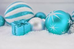 Blue christmas decoration. Background with bauble and gift Royalty Free Stock Images