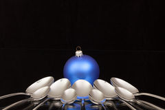 Blue Christmas decoration and nine spoons Royalty Free Stock Photo