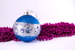 Blue Christmas decoration. With purple mardi gras royalty free stock image