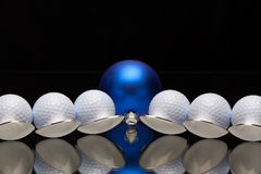 Blue Christmas decoration,six spoons and golf balls Royalty Free Stock Photo
