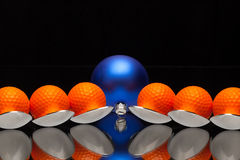 Blue Christmas decoration,six spoons and golf balls Stock Photos