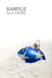 Blue christmas decoration in snow with copy space Stock Photo
