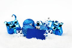 Blue christmas decoration with wishes card on snow Stock Photography