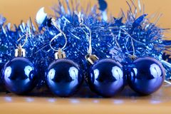 Blue Christmas decorations. On golden shiny background Stock Photography