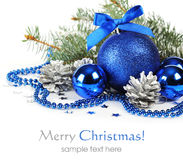 Blue christmas decorations. And silver pine cones over white background Stock Photo