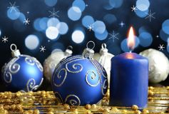 Christmas decorations with burning candle. Royalty Free Stock Photos