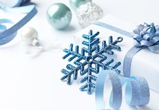 Christmas decorations and a gift box on white background. Close-up stock photos