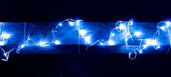 Blue Christmas garland on a wooden bar Stock Photo