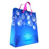 Blue Christmas Gift Bag with Picture Isolated On White. Xmas Decoration. New Year Decor. Christmas Baubles. Clipping Path. Three-D Royalty Free Stock Photo