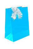Blue Christmas gift bag on white Stock Photos