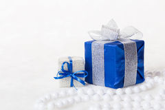 Blue Christmas gift box with shiny silver ribbon and beads Royalty Free Stock Images