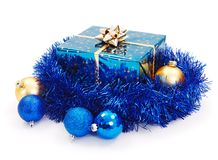 Blue Christmas gift surrounded with blue garland Royalty Free Stock Photo