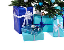 Blue Christmas gifts under tree Stock Photo
