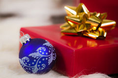 Blue christmas glass bulb and red gift royalty free stock photo