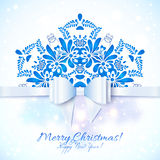Blue Christmas greeting card with bow Royalty Free Stock Photo