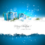 Blue Christmas greeting card. With gift boxes and branches in snow and with place for text stock photography