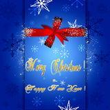 Blue Christmas greeting card. Christmas card with red bow and wishes a Happy New Year and Christmas Royalty Free Stock Photography