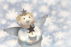 Blue christmas or guardian angel  with snowflakes for decoration Royalty Free Stock Photography