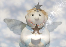 Blue christmas or guardian angel  with snowflakes for decoration Royalty Free Stock Photos