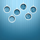 Blue Christmas hanging ball on blue background Royalty Free Stock Photography