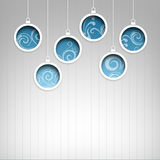Blue Christmas hanging ball on ice background Stock Photos
