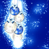 Blue Christmas. Christmas illustration with colorful blue balls and snowflakes. Christmas Greeting Card 2015.Bright winter background with beautiful  toy balls Stock Photos