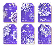 Blue Christmas labels with origami white snowflake. Stock Photos