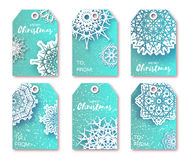 Blue Christmas labels with origami white snowflake. Stock Photo
