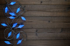 Blue christmas lights. On wooden background Stock Photo