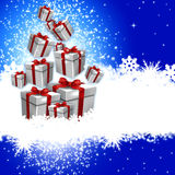 Blue Christmas. Magic fairytale christmas. Blue background with shaft of gift boxes Royalty Free Stock Photos