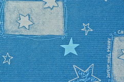Blue Christmas motive on paper carton with blurry effect Royalty Free Stock Photos