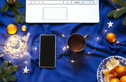 Blue Christmas New Year flat lay on the bed blanket with the laptop keyboard. stock photo
