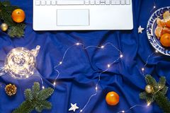 Blue Christmas New Year flat lay on the bed blanket with the laptop keyboard. royalty free stock photos