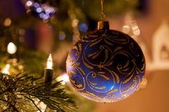 Blue christmas ornament. On a christmas tree with christmas lights Stock Photography