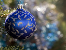 Blue Christmas ornament. Blue Christmas bauble on a tree Stock Images