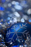 Blue christmas ornament - blue silvery background Royalty Free Stock Images