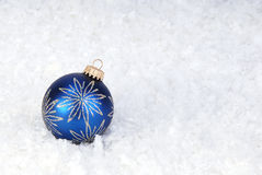 Blue Christmas ornament on snow Stock Photos