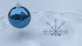 Blue christmas ornament with snowflake on white snow background. Royalty Free Stock Photos