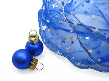 Blue christmas ornaments. Blue ribbon with silver stars and two christmas balls, on white background Stock Images