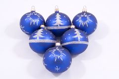 Blue Christmas ornaments. A view of six blue Christmas balls or ornaments with artistic wintry scenes, arranged in a pyramid formation.  Isolated against a white Stock Photography