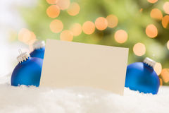 Blue Christmas Ornaments Behind Blank Off-white Card Stock Photo