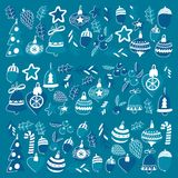 Blue christmas pattern with christmas bells, snowflakes, candy Holly jolly Merry Christmas and Happy New Year. Blue christmas patterns with christmas bells Stock Photos