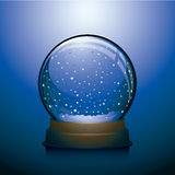 Blue Christmas snow globe. With snowstorm within Royalty Free Stock Images
