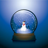 Blue Christmas snow globe. With snowman within Stock Photo