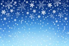 Christmas snow sky background with white and silver snowflakes. Winter holiday backdrop. Blue Christmas snow sky background with white and silver snowflakes and Royalty Free Stock Image