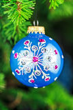 Blue christmas toy on green fir branch Stock Photography