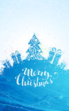 Blue Christmas tree background. Ornate Christmas tree and gifts on bright background. There is copy space for your text on the top and at the foot of the page Stock Photos