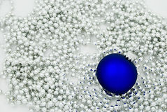 Blue christmas tree ball. With silver chain, isolated Royalty Free Stock Images