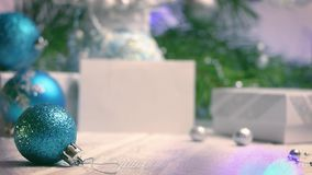Blue Christmas tree ball with new year and cristmas decorations backgroung blur side view. 0:7 sec stock footage